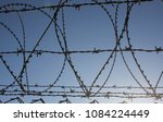 fence of barbed wire | Shutterstock . vector #1084224449