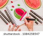 drawing a bright watermelon... | Shutterstock . vector #1084258547