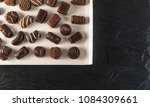 box with chocolate sweets on... | Shutterstock . vector #1084309661