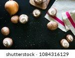 mushrooms champignons in rustic ... | Shutterstock . vector #1084316129