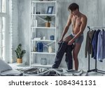 handsome young man in boxer... | Shutterstock . vector #1084341131