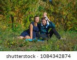 family sitting on the grass | Shutterstock . vector #1084342874