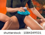 holding the blue ice pack on... | Shutterstock . vector #1084349531