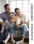 happy mother taking family... | Shutterstock . vector #1084354847