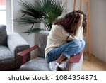 depressed sad woman holding... | Shutterstock . vector #1084354871
