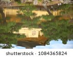specular reflection in water of ... | Shutterstock . vector #1084365824