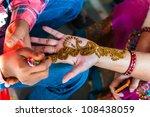 an indian woman gets henna... | Shutterstock . vector #108438059