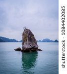 Small photo of Beautiful glimpse of Ha Long Bay in a cloudy day, Vietnam