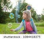 cute preschooler girl playing... | Shutterstock . vector #1084418375