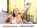 young woman making silly face... | Shutterstock . vector #1084422689