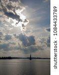 sunlights over flooded church... | Shutterstock . vector #1084433789