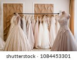 assortment of dresses hanging... | Shutterstock . vector #1084453301