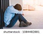 depressed man sitting on floor...   Shutterstock . vector #1084482881