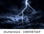 lightning strike on a cloudy... | Shutterstock . vector #1084487669