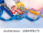 diet concept  slim by pills ... | Shutterstock . vector #1084498175
