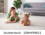 cute little girl and her mother ...   Shutterstock . vector #1084498811