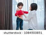 mother dressing up a son for... | Shutterstock . vector #1084503851