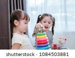 children girls play a toy games ... | Shutterstock . vector #1084503881