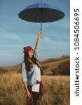 young woman holding umbrellar...   Shutterstock . vector #1084506695