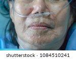 elderly woman with nasal... | Shutterstock . vector #1084510241