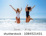 two funny girls with beautiful... | Shutterstock . vector #1084521431