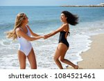 two young women with beautiful... | Shutterstock . vector #1084521461