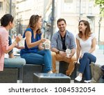 young people having lunch... | Shutterstock . vector #1084532054
