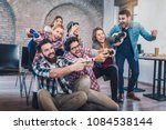 coworkers playing video games...   Shutterstock . vector #1084538144