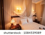 wedding dress on a bed at the... | Shutterstock . vector #1084539089