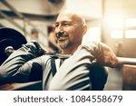fit mature man in sportswear... | Shutterstock . vector #1084558679
