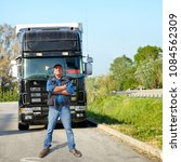 Small photo of Truck driver and truck