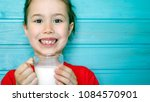cute little girl enjoys the... | Shutterstock . vector #1084570901