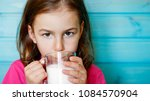 cute little girl enjoys the... | Shutterstock . vector #1084570904