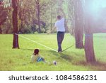 balancing exercise with... | Shutterstock . vector #1084586231
