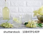 a glass of homemade elderflower ... | Shutterstock . vector #1084591409