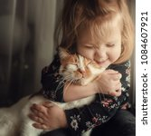 portrait of a small cute child... | Shutterstock . vector #1084607921