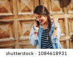 young woman receiving good news ... | Shutterstock . vector #1084618931