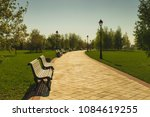 A Path With Benches In The Par...