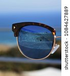 Small photo of View of Curium in Cyprus through sunglasses