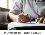 close up students writing and... | Shutterstock . vector #1084633607