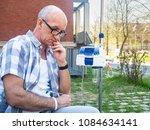 patient undergoing chemo... | Shutterstock . vector #1084634141