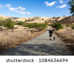 Stock photo fit middle age man age walking black labrador retriever puppy dog east shore trail del valle 1084636694