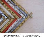 Small photo of Rulers and scales in metric and inches form a chevron chart or graph representing accuracy, measurement, increase, growth and results with copy space.