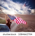 young woman holding american... | Shutterstock . vector #1084662704