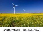 wind turbines. fields with... | Shutterstock . vector #1084663967