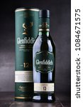 Small photo of POZNAN, POL - MAY 3, 2018: Bottle of Glenfiddich, the world's best-selling single-malt whisky, owned and produced by William Grant and Sons in Dufftown, Scotland