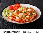 serving mexican entomatadas... | Shutterstock . vector #1084673261