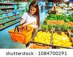 woman buying vegetables in... | Shutterstock . vector #1084700291