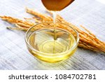 rice bran oil | Shutterstock . vector #1084702781