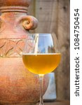 glass of beer and stone jug in... | Shutterstock . vector #1084750454